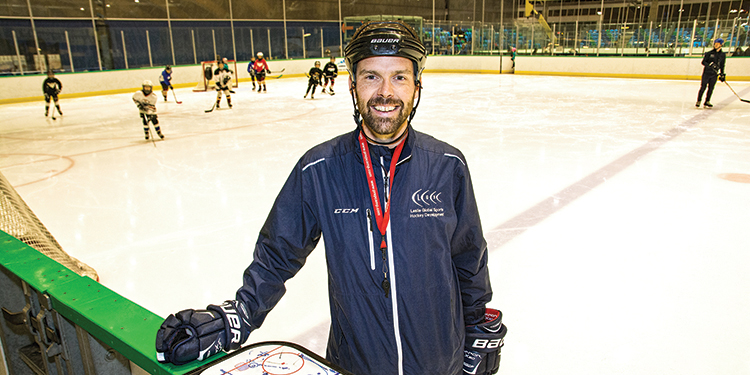 Hockey instructor taking the game global