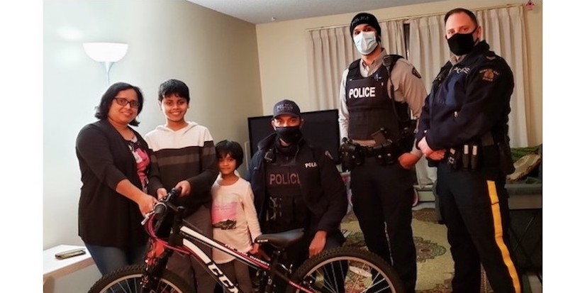 Police present Richmond boy, 12, with new bike